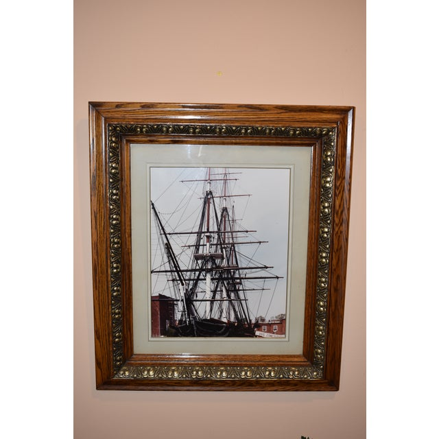 "Beautiful framed print under glass of ""USS Constitution"" under glass. Very nice solid wood frame in an oak finish with..."