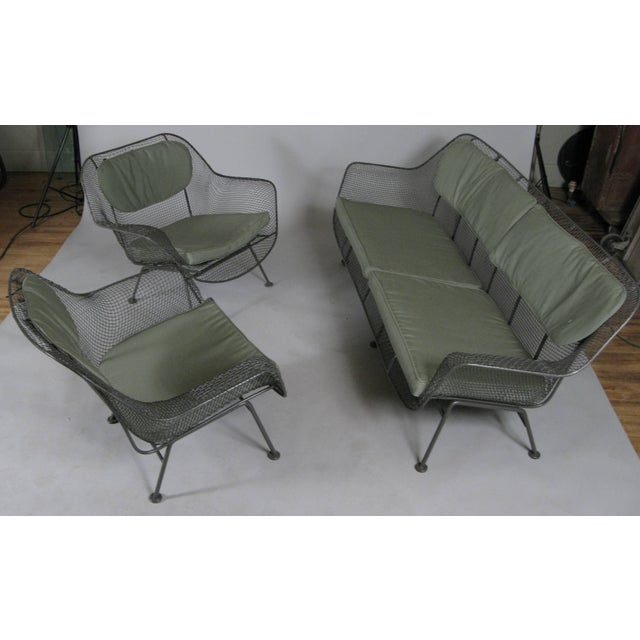 A set of Sculptura lounge seating by Russell Woodard, circa 1950. Set includes a long four seat sofa, and a pair of large...