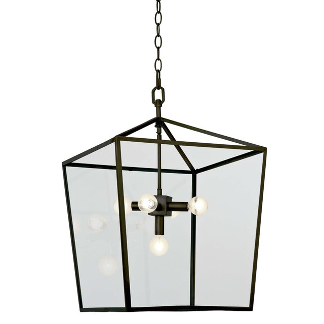 Timeless elegance with a lantern that is radiating refined. This clean-lined lantern is crafted of steel with a oil rubbed...