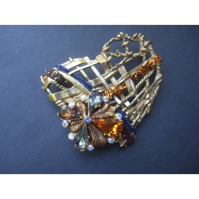 CHRISTIAN LACROIX Paris Gilt metal crystal heart brooch The unique heart-shaped brooch is designed with a series of...