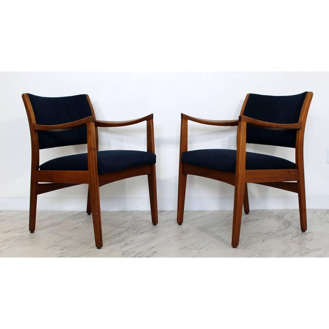 For your consideration is a gorgeous pair of walnut armchairs, by Johnson Furniture Co, circa the 1960s. In excellent...