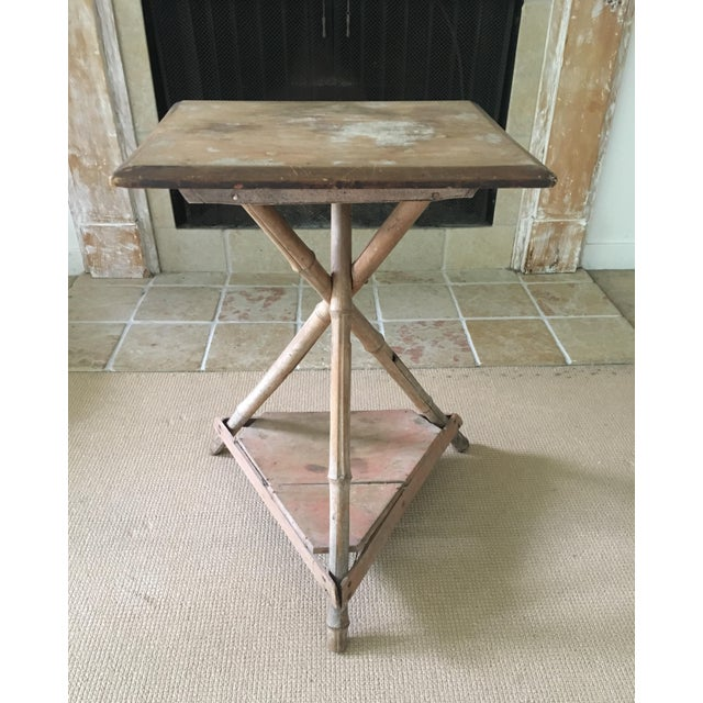 This lighthearted bamboo side table hails from the 1950's or 60's. It's perfect for your living room, foyer or right next...