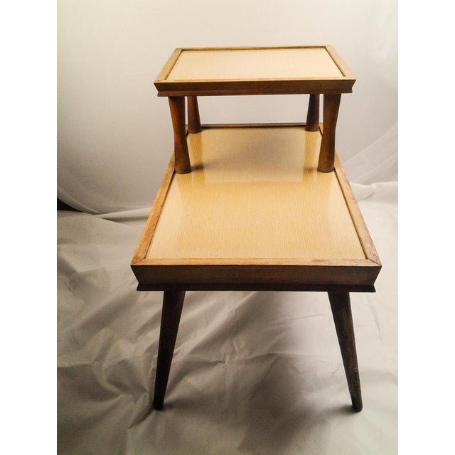 This is a Vintage Mid-Century end table. Very sturdy, made of all wood with veneer tops. It is still light weight but a...