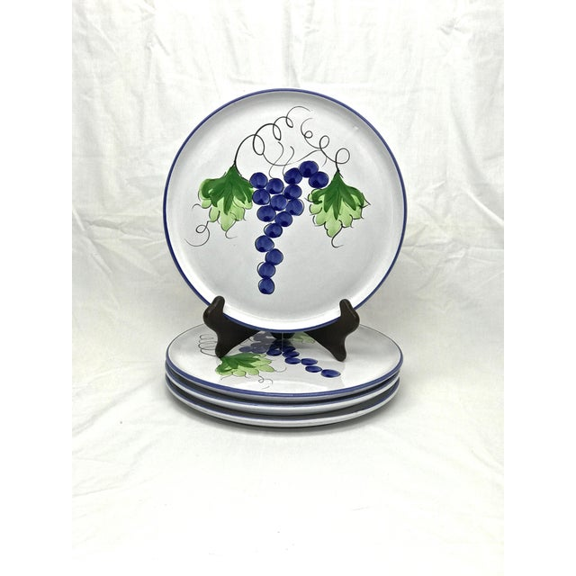 Here is a hand-painted set of four terra-cotta plates and a covered serving dish. The set displays beautiful hand-painted...