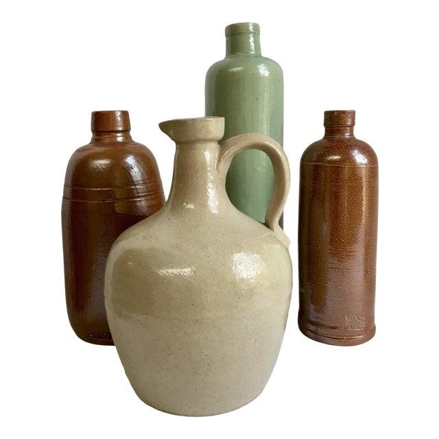 Vintage Neutral Stoneware Bottles - Set of 4 For Sale