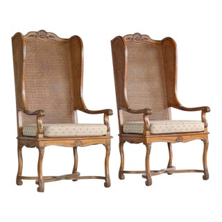 Pair of 1920s Hollywood Regency Cane Wingback Chairs For Sale