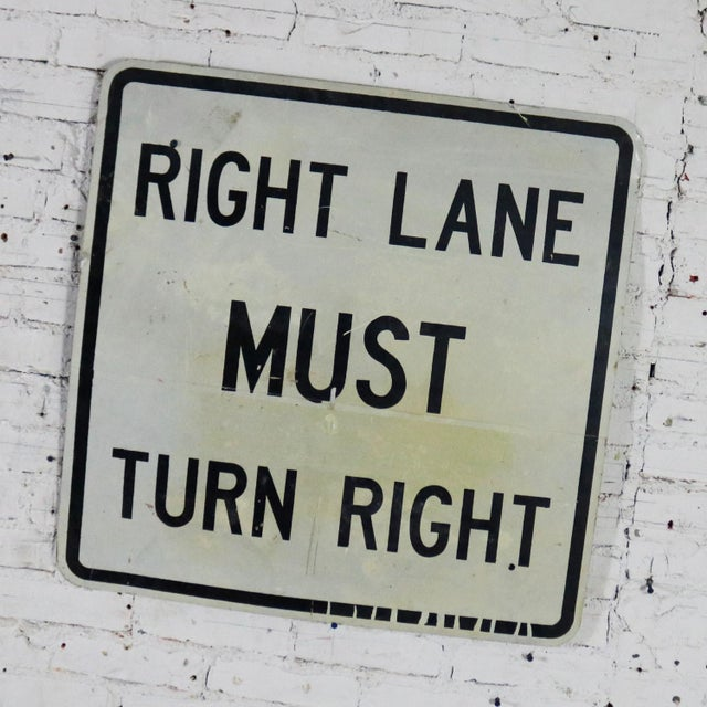 Awesome vintage steel Right Lane Must Turn Right traffic sign. This is a large sign and is in fabulous vintage condition...