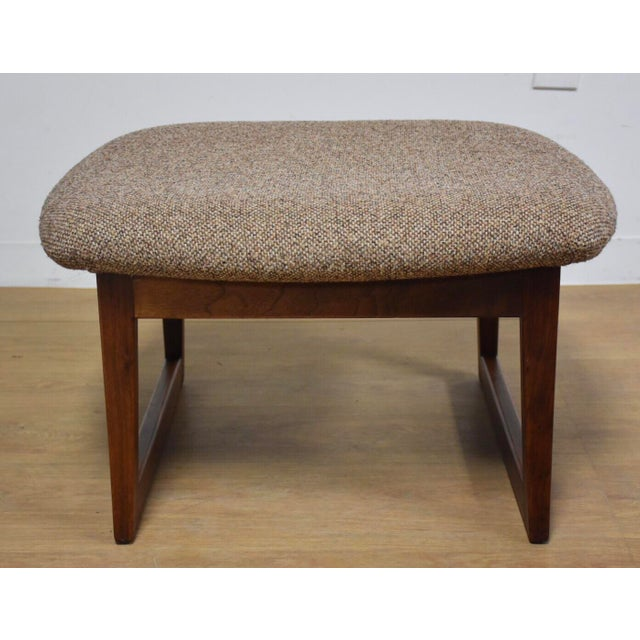 """A mid century modern walnut ottoman designed by Jens Risom. Add this footstool to complete your walnut lounge chair 27.5""""..."""