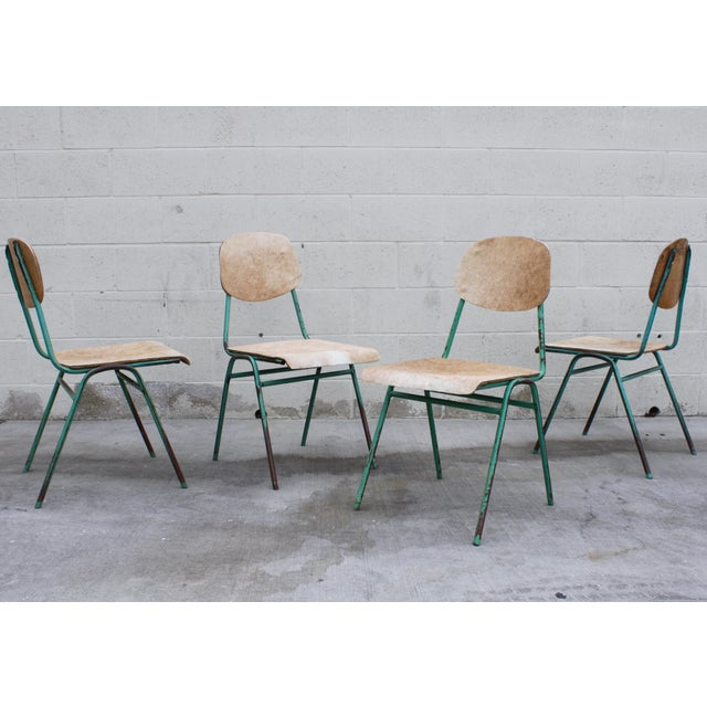 Super cool and showing lots of great patina, these vintage, mid century French school chairs have their original aqua...