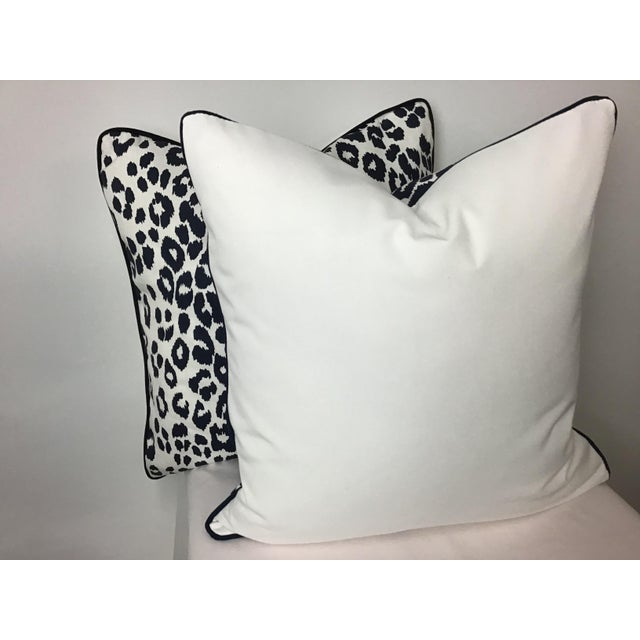 "Classic Iconic Leopard printed linen by Schumacher pair of 22""x22"" pillows in warm white and navy. Pillows have matching..."