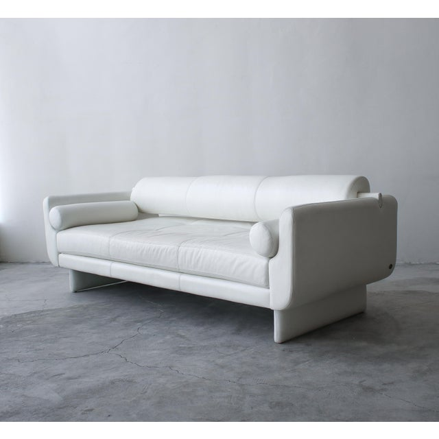 Remarkable white leather Matinee convertible daybed sofa designed by Vladimir Kagan for American Leather Studios. The sofa...