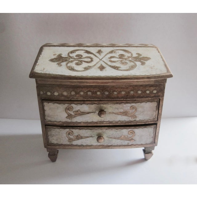A large, lovely two-drawer box with neat arrow-head feet. It also that hinges at the top. Condition is excellent vintage...