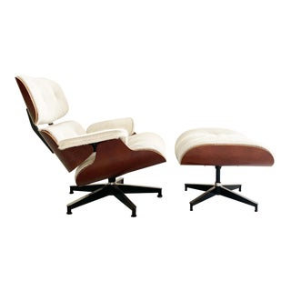 Eames 670 Lounge Chair and 671 Ottoman in Brazilian Cowhide For Sale
