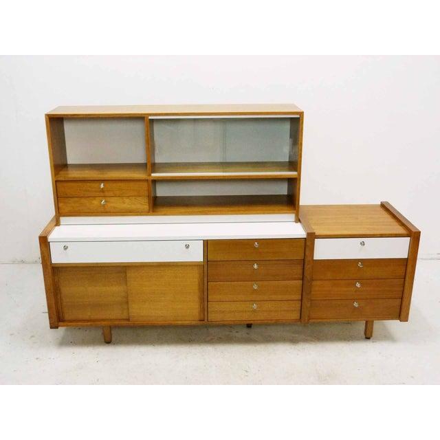 Circa 1950s modular walnut sideboard/credenza by Martin Borenstein for Brown Saltman. A rare collection for Brown Saltman...