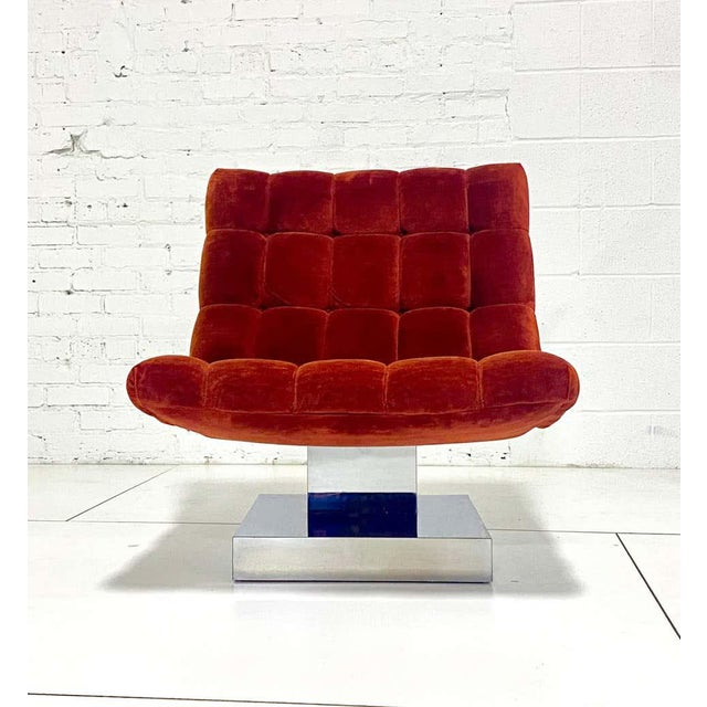 Milo Baughman tufted scoop chair on chrome base circa 1970s. Chrome pedestal gives a floating appearance.