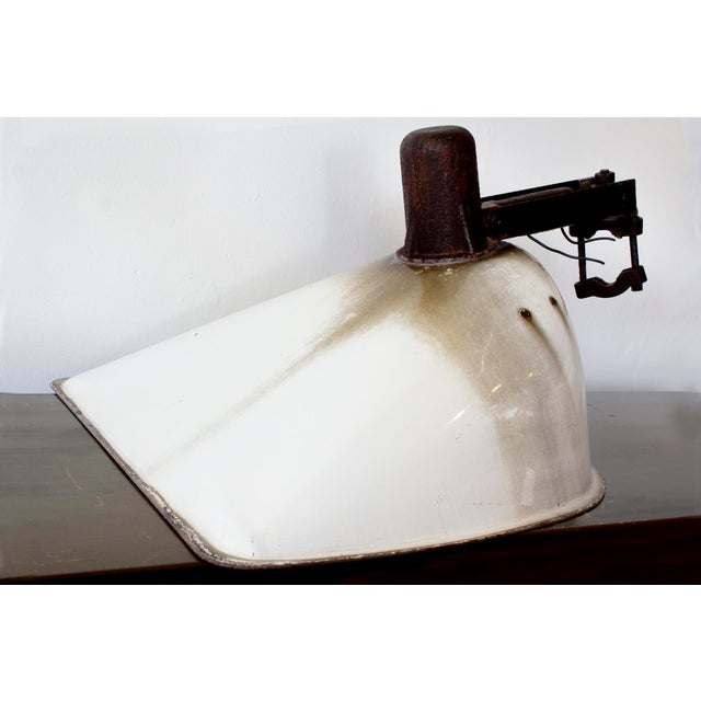 This 1940s Industrial street light is a real beauty. Composed of steel with original porcelain enamel with patina. We're...
