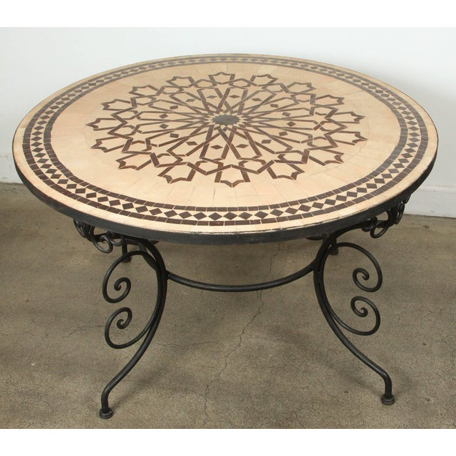 Handcrafted round Moroccan outdoor mosaic tile table 47in diameter on iron base. Classic and elegant Moroccan outdoor...