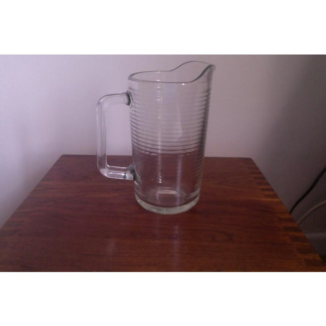 Mid century glass pitcher with concentric glass circles. Perfect as a decor element, a vase, or a pitcher, of course.