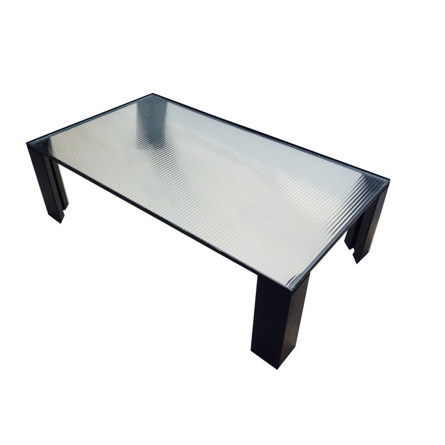 This is an amazing Italian modernist cocktail/coffee table. Elegant steel frame with black painted finish, very light,...