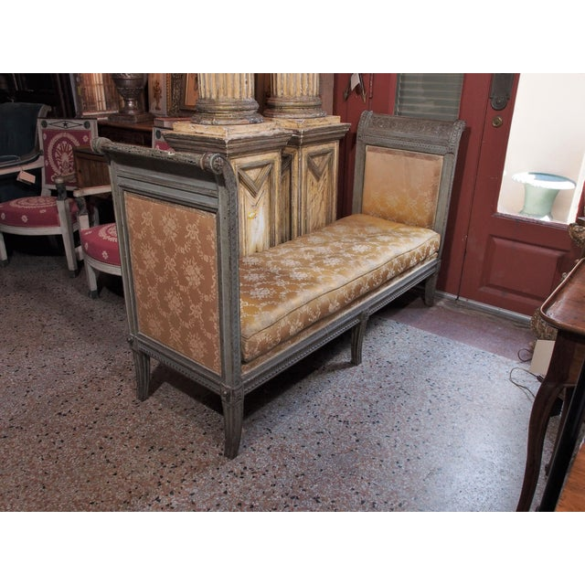 18th century Louis XVI carved and painted banquette/recamier. The padded sides curling backwards, each carved with a...