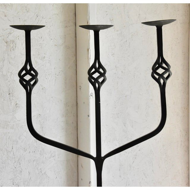 Vintage wrought iron 3-pillar floor candelabra. Tripod base. Ornate twisted iron detail. Black color wrought iron. Overall...