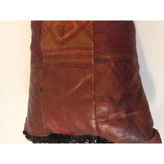 African Tuareg hand tooled leather pillow. Great colors, hand-painted with tribal geometric design with long leather...