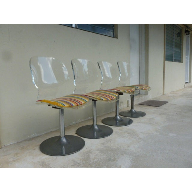 Set of 4 Stunning 1970's upholstered chrome edged and lucite leg dining chairs sold as found in a vintage condition in...