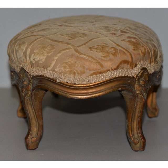 Late 19th to Early 20th Century Carved & Gilded French Walnut Foot Stool Beautifully carved and upholstered foot stool...