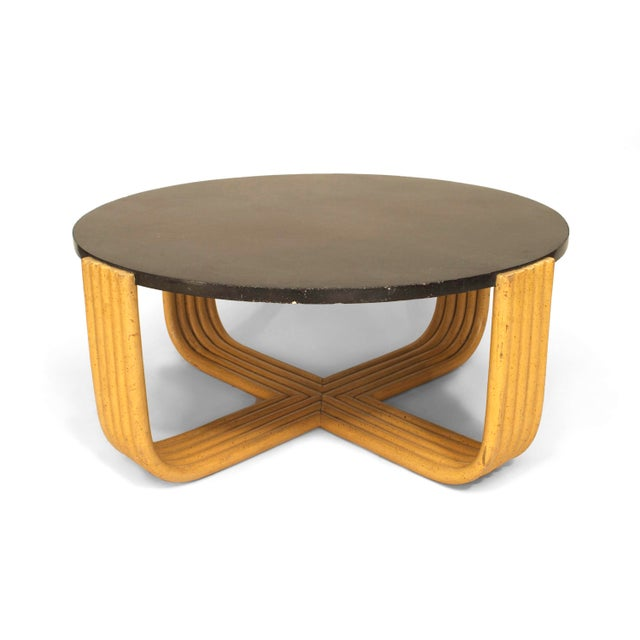 American Art Moderne 1930s coffee table with a light beige painted faux bamboo design base supporting a black bakelite...