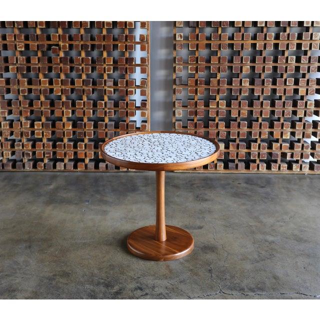 "Ceramic tile-top occasional table by Gordon Martz. Measures: 24"" diameter x 22.5"" tall."