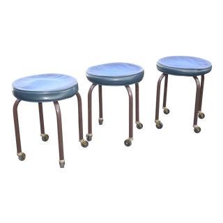 Three Vintage Mid Century Modern Blue Stools on Castors For Sale