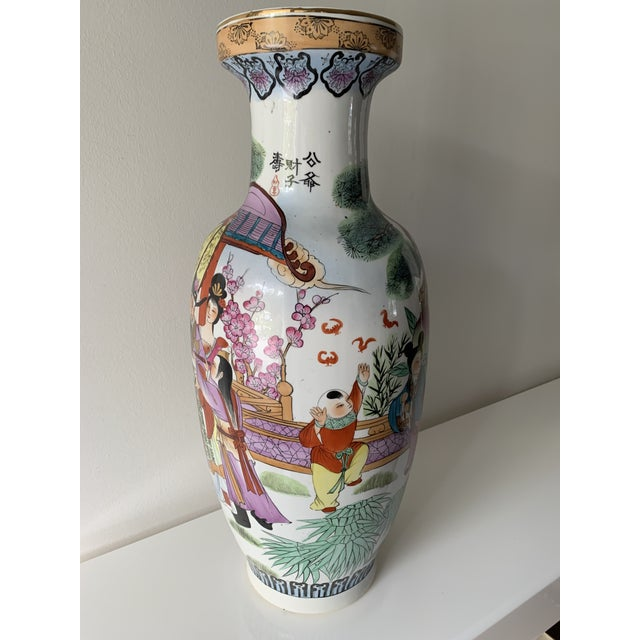 Antique Chinese Famille porcelain vase with bright purple, greens, pinks, yellows etc. with touches of gold. Figures...