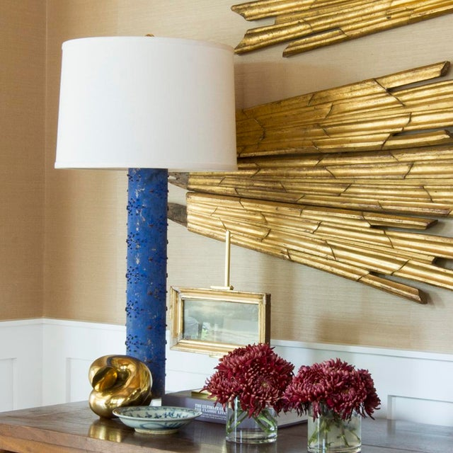 This vintage table lamp is built from a repurposed wallpaper print roller and will make a statement in any room. It sits...