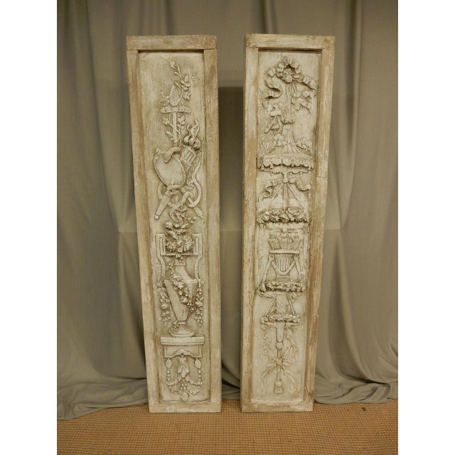 Pair of French classical plaster reliefs. Circa mid 19th century.