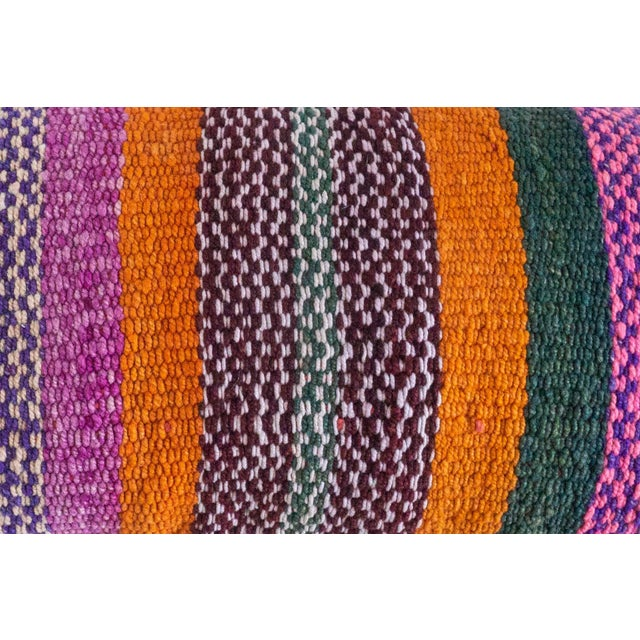This striped pillow was made in the Cusco region of Peru from a vintage Peruvian frazada. This multi colored pillow comes...