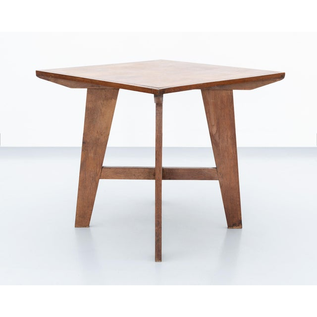 A lovely mahogany dining table with compass legs in the style of Jean Prouve. France, 1950s.