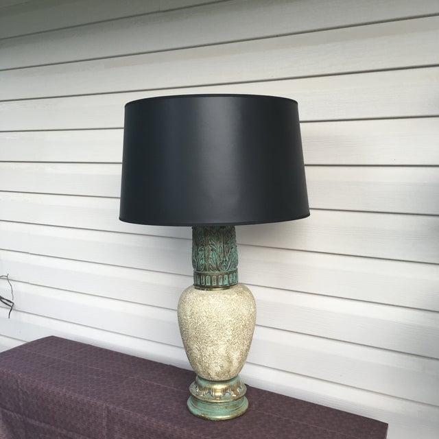 "Mid-century modern vintage table lamp made by Cambridge. Lamp body measures 21"" tall. Base and top are cast iron with..."