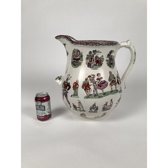 A truly giant Staffordshire pottery pitcher in the fanciful Harlequin pattern, made by Elsmore and Forster, English, circa...