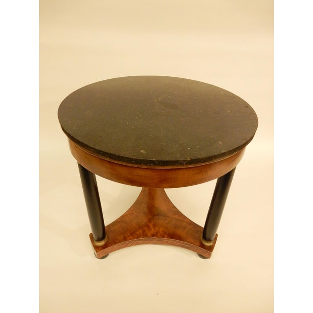 19th century French Empire Gueridon with original black marble top. Base carefully restored.