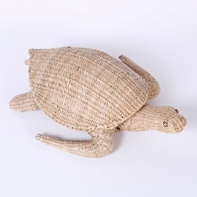 Amusing folky turtle sculpture or box crafted in wicker and ingeniously woven over a metal frame with a naive quality and...