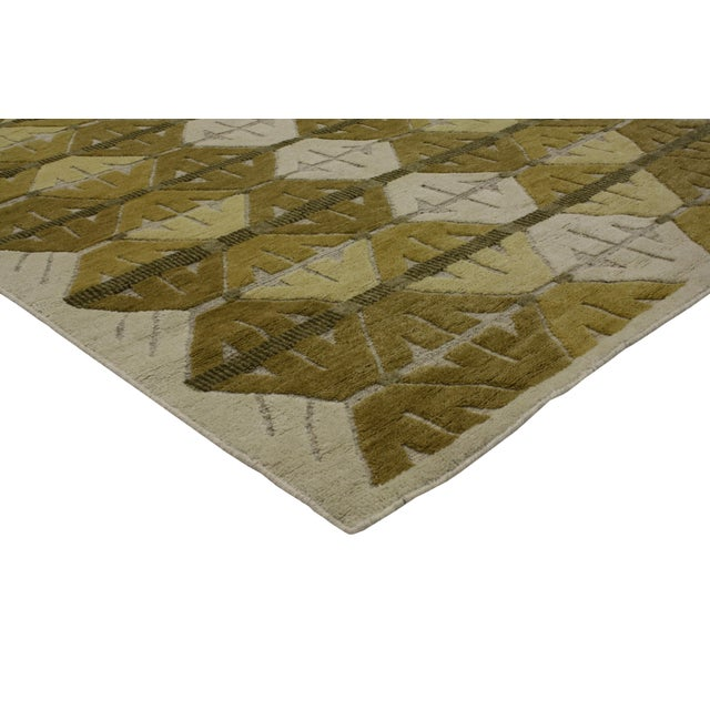 Spike the energy in your space with graphic geometric design found in this contemporary Mid-Century Modern style rug. It...