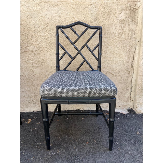 This set of four mid-century faux bamboo chairs have been refreshed in luxe black lacquer and a rich printed Belgian linen...