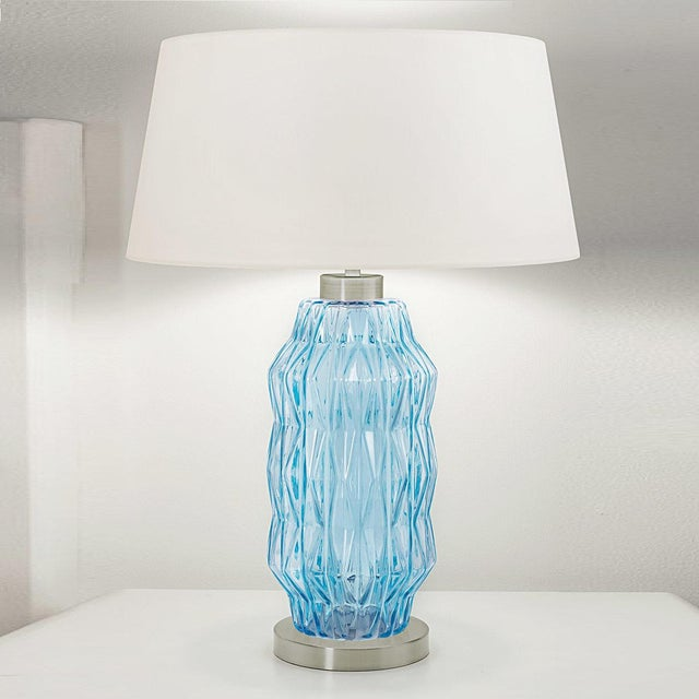 Aqua glass hand blown lamp with a geometric pattern on a brushed nickel base. Complete with linen shade and silver silk...