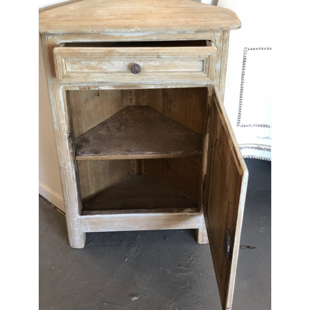 This bleached oak gray washed corner cabinet would be a perfect fit for any room requiring small storage space. Cabinet...