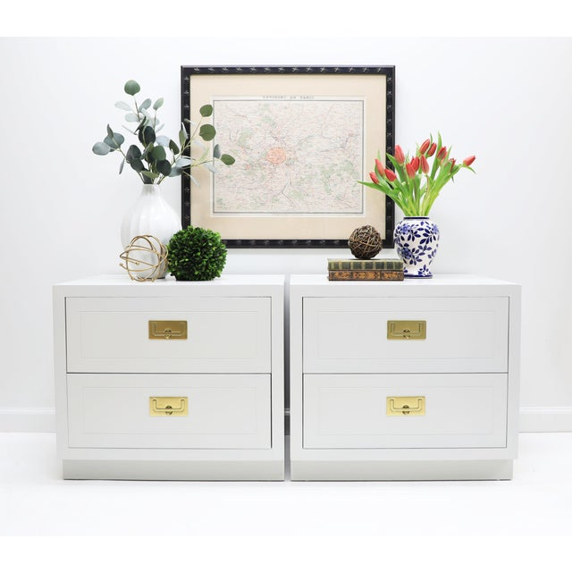 This pair of classic Henredon Campaign style nightstands have been painted a very pale shade of gray and the two...