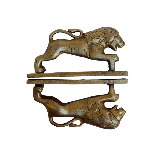 A pair of gold brass lion door handles or cabinet pulls. Hollywood Regency in style, with intricate carving throughout. In...