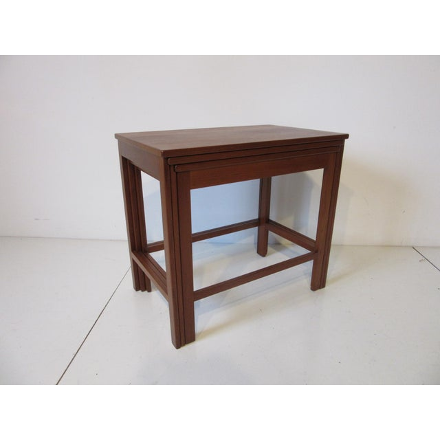 A set of three well crafted nesting tables in solid teak wood, retains the manufactures tag by France and Son Denmark .