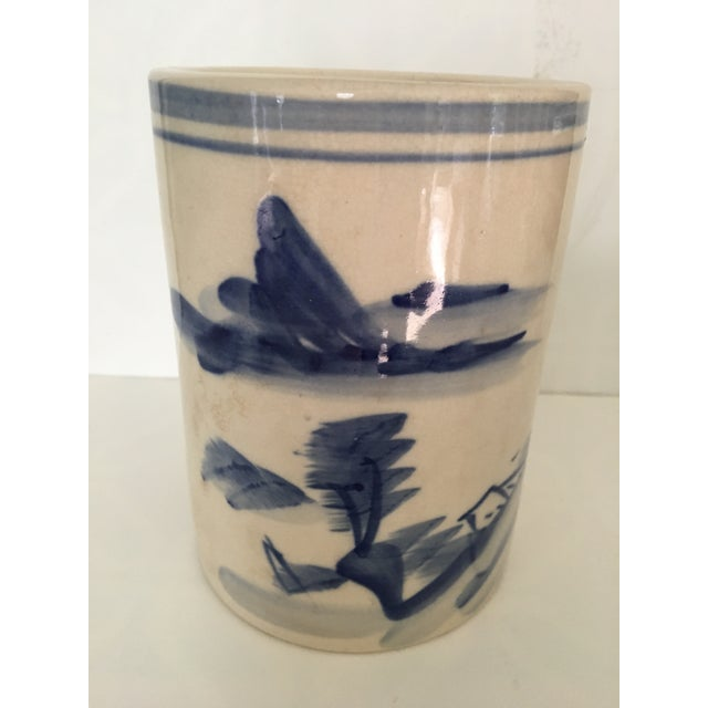 Lovely, vintage, Chinese brush pot in blue and white with scenes of mountains , trees and house on the front. On the...