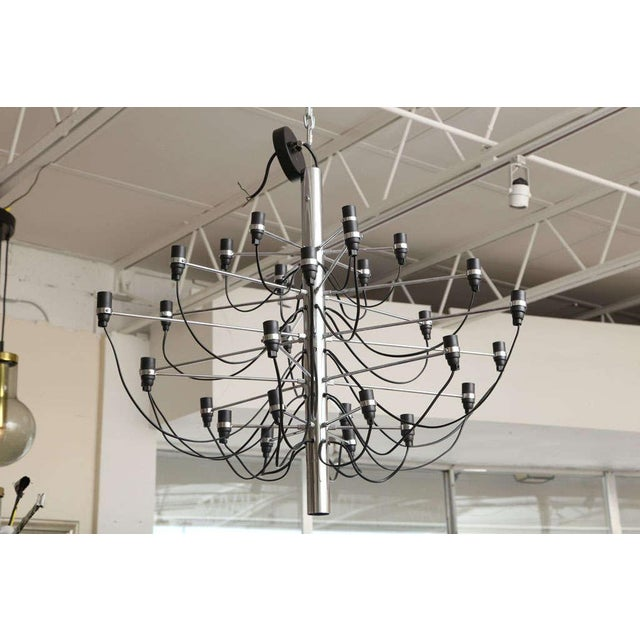Offered is an original Flos chandelier, designed by Gino Sarfatti. The chandelier is in perfect working condition and uses...
