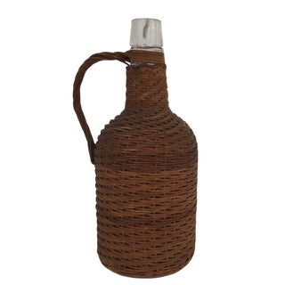 Early 20th Century Wicker Covered Demijohn With Handle For Sale